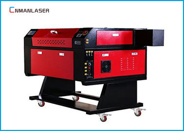 China Small Desktop 50w 60w CO2 Laser Engraving Cutting Machine For Fabric Textile factory